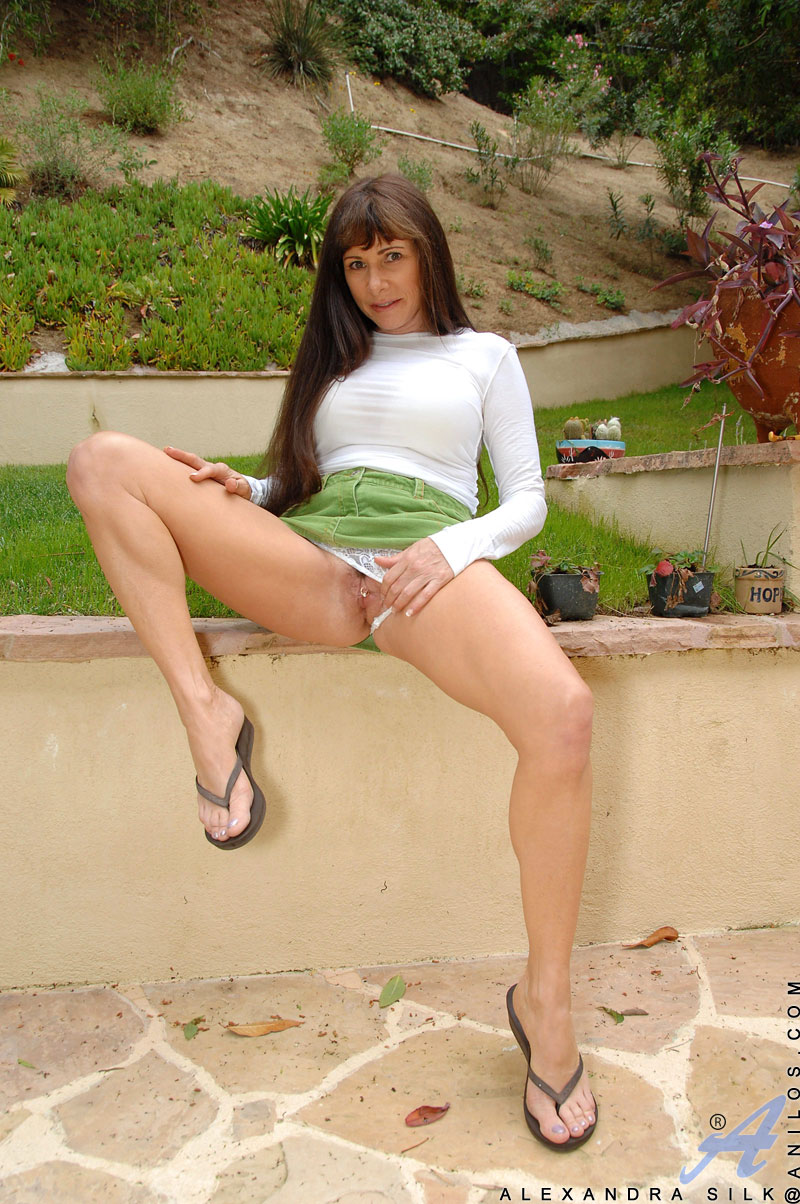 Naughty Alexandra Silk shows off her milf breasts and fingers her ...