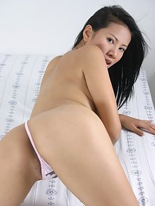A huge dildo inside a wet asian hairy pussy