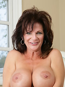 Busty mature brunette gets fucked in her ass