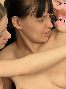 Two charming teen girls experiencing their first lesbian sex in these pics