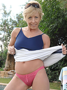 Mature Anilos cougar Chanel stuffs her mature pussy with the rabbit outdoors