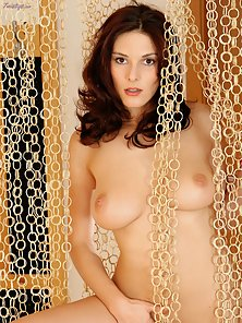 Busty brunette Allegra takes off her pink dress and spreads her pussy