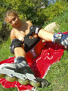 Rollerblade girl gets naked and fingers herself in the middle of a public park.