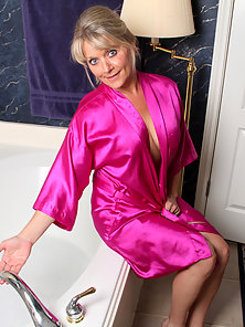 Peek in on the hot mom next door getting naughty in her bath