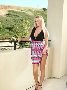 Long haired blonde Holly teases us with her enticing beauty outdoors