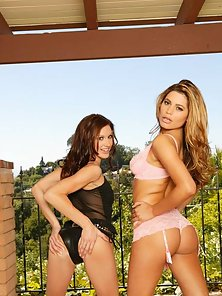 Taylor Rain and Paola Rey play on the patio