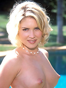 Sabrina Snow is a hot blonde in stockings with pierced nipples