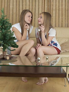 Gorgeous brunette lesbians celebrate their holiday with great lust as they get near to the gift of s