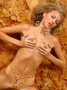 Naked blonde bunny lying on the floor touching her boobs and stripping off her panties