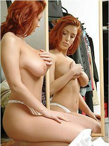 Hot redhead babe shows off her perfect natural breasts