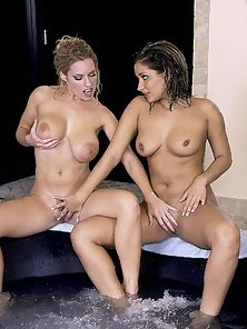 Two Babes Have Girl on Girl Fun In the Hot Tub