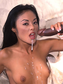 Sexy asian babe sucking a black dick and gets cum shot in her mouth