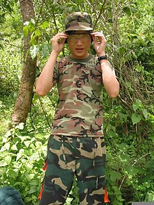 Young soldier get off his camouflage suit and jack off