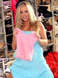Adorable Brittany strips and plays dress up in her closet