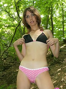 Her sexy panties go off and charming Amber playfully spreads her shaved pussy in a forest.