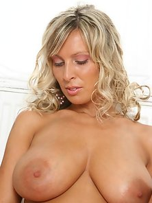 MILF-able Milly wants you to help dirty up the bathroom with her