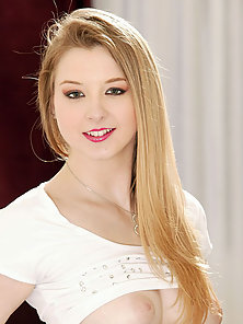 Sunny Lane bends over to show her big ass small anus and smooth pussy