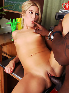 Petite blonde takes a black cock