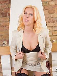 Horny milf slips out of her office attire