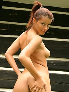 Female takes off her white panties and stretches pussy lips open