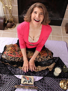 Naughty granny meditates before pulling up her skirt