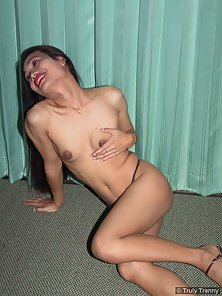 Slender shemale with small tits wearing skimpy thongs