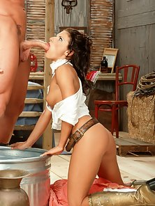 Dominica Leoni in a cowgirl outfit riding and sucking her cowboy man