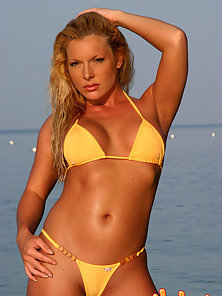 Hot blonde in a yellow bikini.