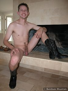 Dirk shows off his massive hard on by the fireplace
