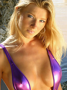 Stunning blonde in a hot purple sling bikini