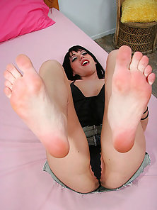 Brunette sluts strokes a hard cock with her pink painted toes