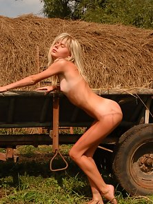 This hot blond girl wallows in the grass showing all her amenities and desire to you.