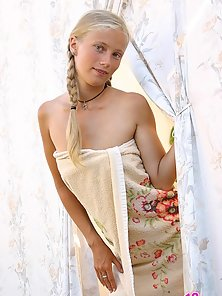 Cute teeny Anna has just got from the shower and uncovers her delicate body and virgin smooth slit.