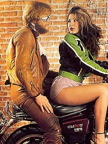 Seventies biker babe gets to please two big cocks at once