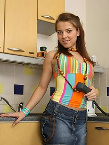 Hot teen girl naked in kitchen