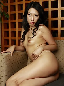 Sexy and horny Japanese babe Ozawa Chris is posing topless