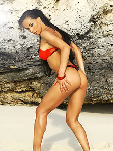 Hot Brunette Strips Out Of Red Bikini On The Beach