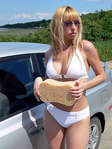 Amateur teen gets soapy while washing a car