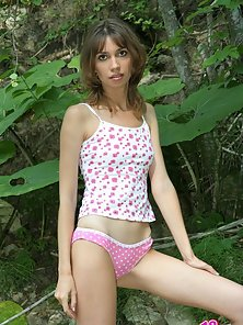 Raunchy Amber likes to expose her fantastic body in the woods, revealing cute tits and moist pussy.