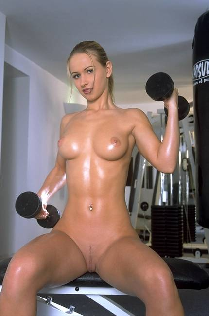 Sexy nude girl bodybuilder working out