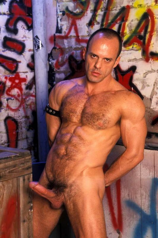 hairy stud wearing sexy leather chaps sucks cock ass point