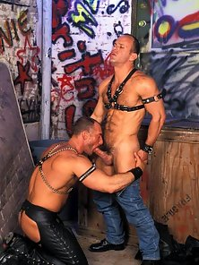 Hairy stud wearing sexy leather chaps sucks cock
