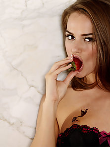 Tori Black with strawberries, chocolate syrup and her wet pussy.