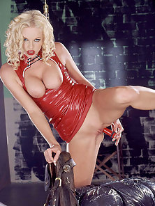 Sexy Blonde In Red Latex Pleasuring Herself