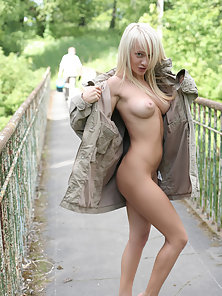Hot Blonde Gives Side by Side Pose for Viewer at Outdoor