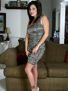Sweet cougar Lola Lynn wears a wild leopard dress that hugs her curves tight