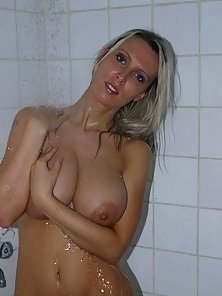 Busty Milly in the shower playing