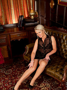 Irresistible milf beauty taunts in sheer panties and stockings