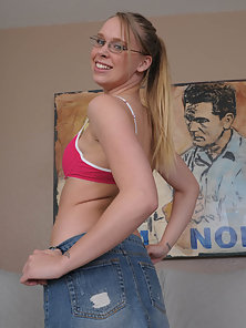 Adorable blonde teen spreads her lips and takes a load on her glasses