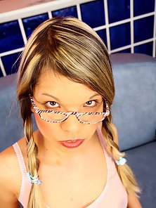 Dirty teenie with glasses gets covered with thick semen